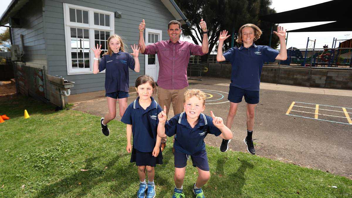 BUILDING FUTURE: Merrivale Primary School principal Simon Perry with students Isabelle Collins, Maggie Shiells, Darby Schultz, and Gilbert Harrison. Picture: Mark Witte