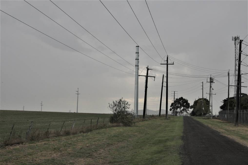 Metal pylons erected to carry transmission lines from the Salt Creek wind farm stand over standard power poles near the Terang terminal station.