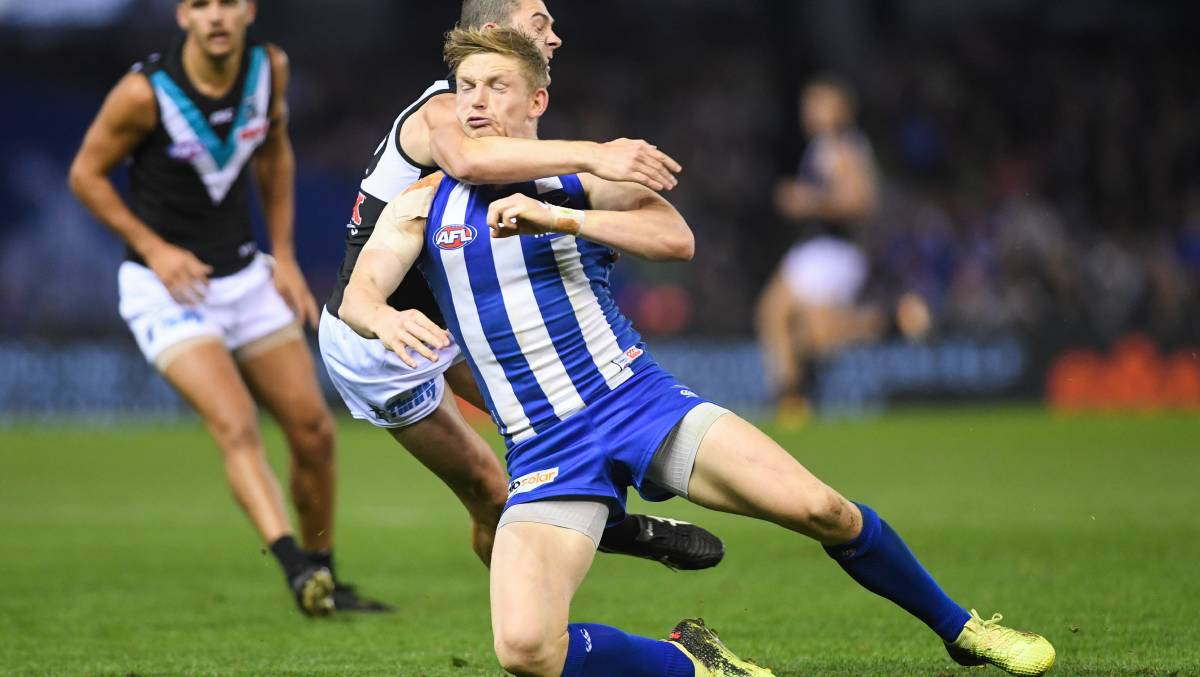 Too high: North Melbourne skipper Jack Ziebell is tackled by Port Adelaide's Darcy Byrne-Jones in 2018. Picture: Morgan Hancock