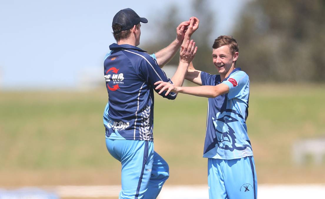 PUMPED: Wesley-CBC's Walker Owen (right) celebrates a wicket with Ben Evans. The Beavers defeated Port Fairy at Walter Oval on Saturday. Picture: Mark Witte