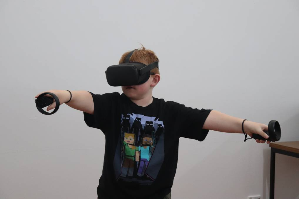 GAME TIME: Alex Atkinson, 9, was thrilled to have a go at the virtual reality at One Day Studios' school holiday program Legends VR. The studio plans to expend its digital technology space into content creation, film, robotics and more. Picture: Kimberley Price