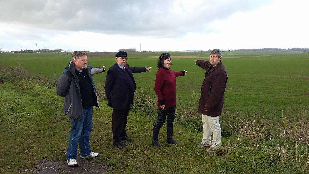 Battle ground: Portland's Rick Rowbottom (left), Port Fairy's Max and Maria Cameron and French author and activist Gilles Durand survey the Bullecourt battlefield earmarked for a wind farm.