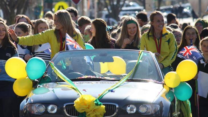 Kellie White and Emily Smith were honoured with a street parade in their home town of Crookwell on Friday after winning a gold medal with the Hockeyroos at the 2014 Glasgow Commonwealth Games.  Photo: Crookwell Gazette